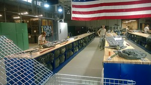 Army 10th Special Forces Soldiers folding parachutes at parachute rigging facility